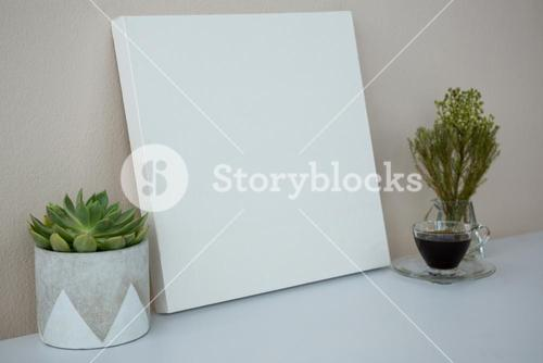 Plants with coffee and placard