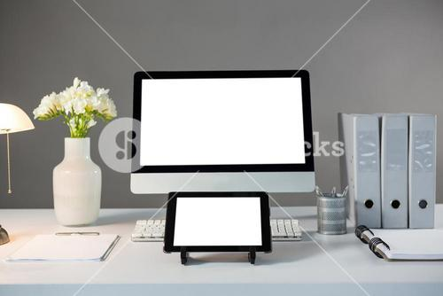 Desktop pc and digital tablet with flower vase