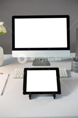 Desktop pc with digital tablet on table