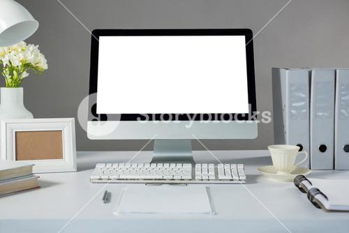 Desktop pc with picture frame and cup of coffee