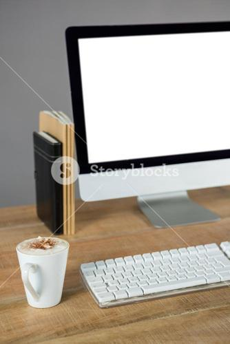 Desktop pc with cup of coffee and diary