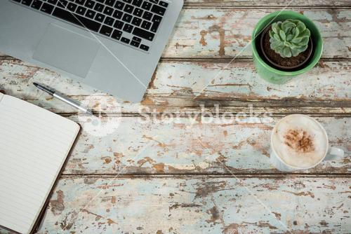 Laptop and diary with cup of coffee