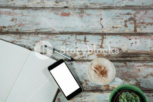 Smartphone, cup of coffee with diary