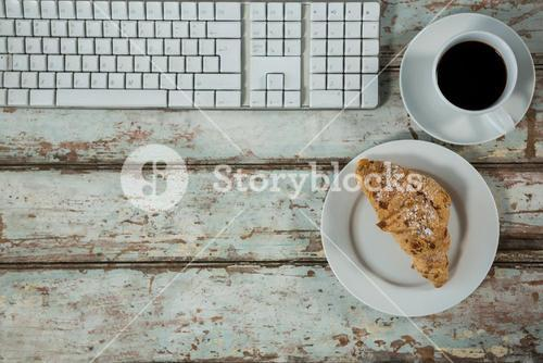 Keyboard, coffee cup and cookies