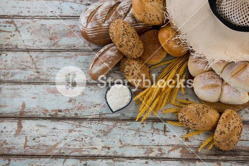 Variety of breads with wheat grains and flour