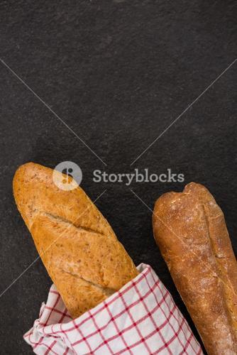 Baguette wrapped in napkin