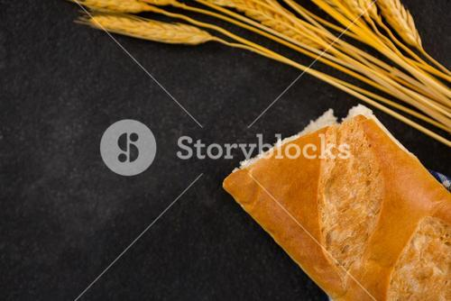 Baguette and wheat grains