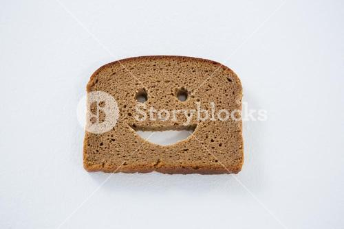 Smiley face on bread slice