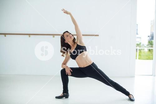 Dancer performing stretching exercise