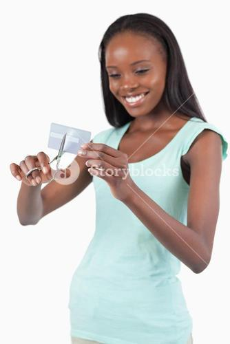 Smiling woman cutting her credit card into pieces