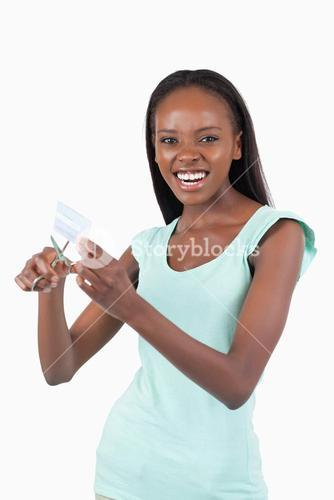 Angry woman destroying her credit card