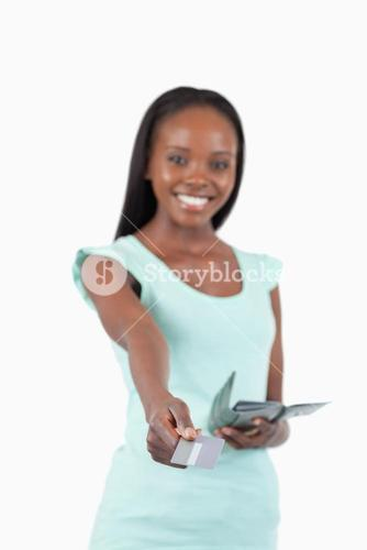 Smiling young woman paying with her credit card