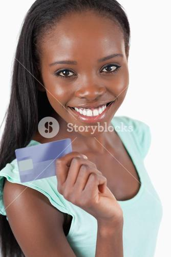 Smiling young woman with her new credit card