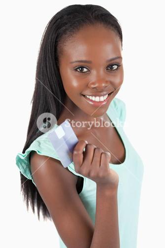 Happy smiling woman with her credit card