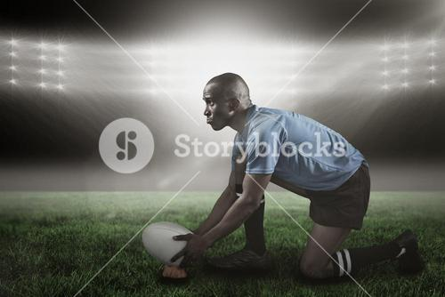 Composite image of confident rugby player looking away while keeping ball on kicking tee 3d