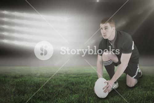 Composite image of rugby player ready to make a drop kick and 3d