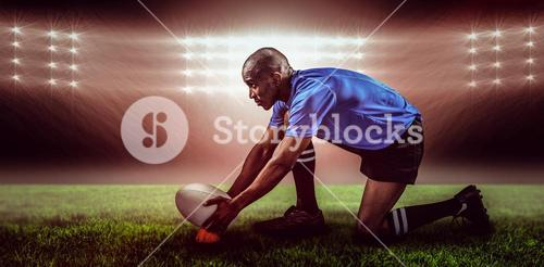 Composite image of rugby player keeping ball on kicking tee and 3d
