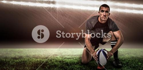 Composite image of portrait of rugby player in black jersey placing ball and 3d