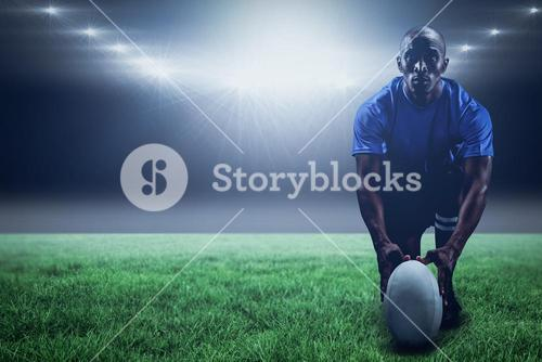 Composite image of portrait of rugby player holding ball while kneeling and 3d