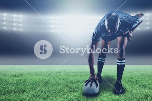 Composite image of rugby player taking position and 3d