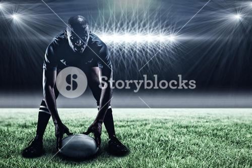 Composite image of sportsman holding ball while playing rugby and 3d