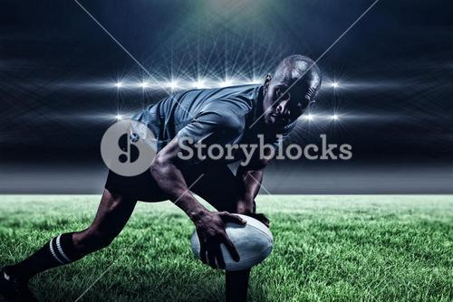 Composite image of determined sportsman looking away while playing rugby and 3d