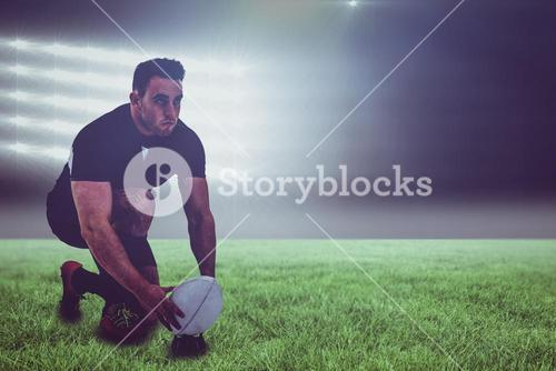 Composite image of rugby player getting ready to kick ball and 3d