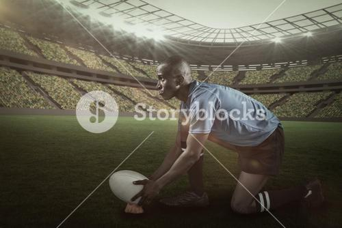 Composite image of confident rugby player looking away while keeping ball on kicking tee with  3d