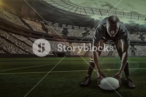 Composite image of portrait of sportsman holding ball while playing rugby with 3d