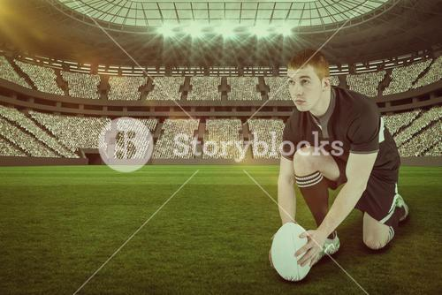 Composite image of rugby player ready to make a drop kick with 3d