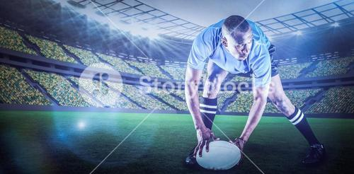 Composite image of rugby player holding ball while playing with 3d