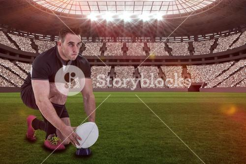 Composite image of rugby player getting ready to kick ball with 3d