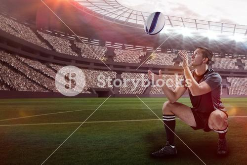 Composite image of full length of rugby player catching the ball with 3d