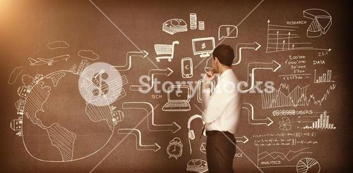 Businessman looking at drawings on the wall 3d
