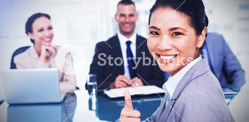 Young applicant giving thumb up after obtaining the job