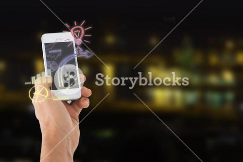 Composite image of male hand holding a smartphone 3d