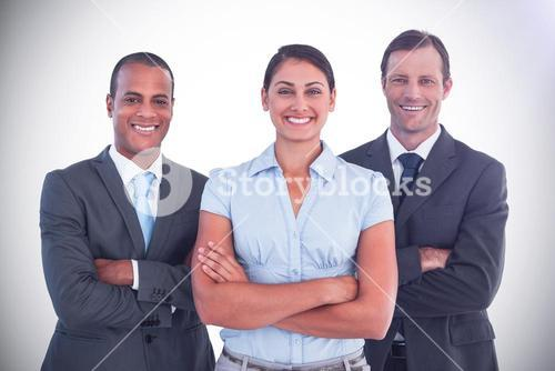 Small group of smiling business people standing together