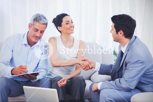 Salesman closing a deal withcouple