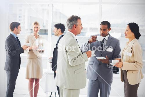 Business people chatting and drinking coffee at a conference