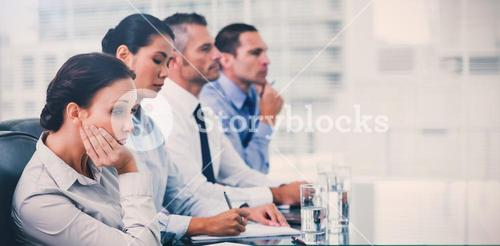 Businesswoman getting bored while attending presentation