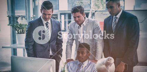 Concentrated businessmen looking at computer