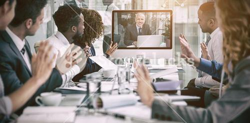Business people looking at screen during video conference