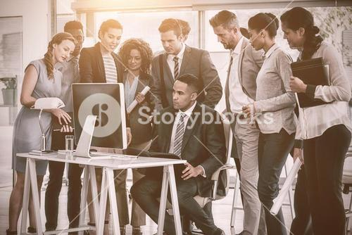 Business people looking into computer