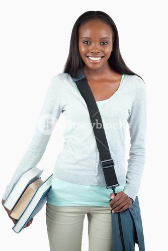 Smiling young student with books and bag