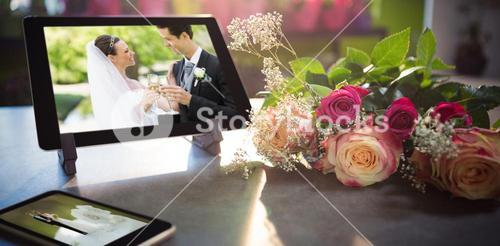 Composite image of mobile phone and tablet on table