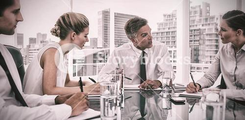 Serious businessman during a meeting talking to his employees