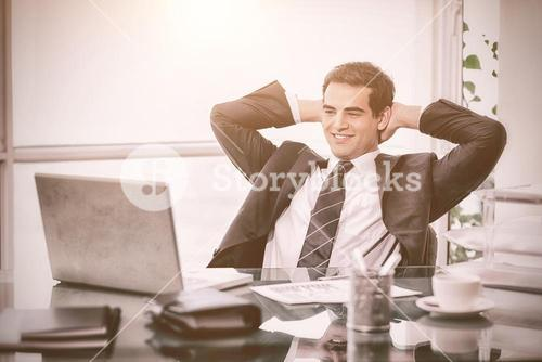 Relaxed businessman working with a laptop