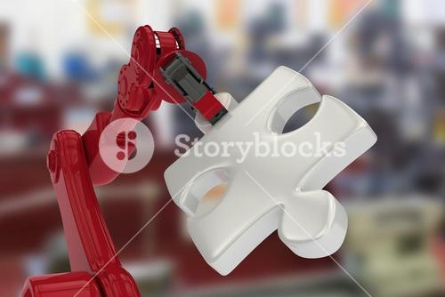 Composite image of closeup of red robotic hand with gray jigsaw piece 3d