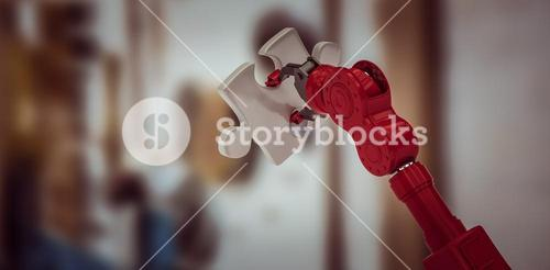 Composite image of cropped of red robotic hand holding puzzle piece 3d