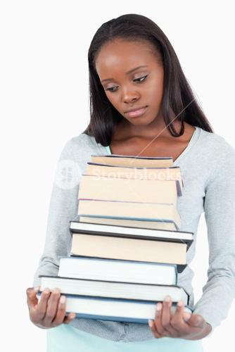 Sad woman with pile of books looking to the side